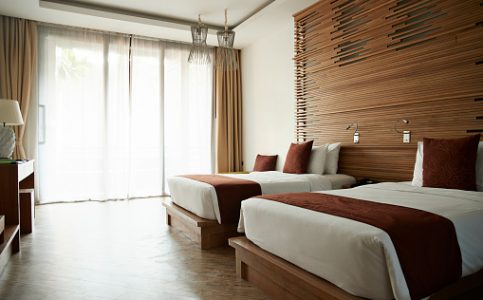 View of beds in hotel room at tourist resort
